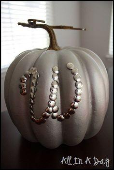 thumbtacks, pumpkin, and spray paint
