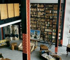 The natural light to the right is coming from a full height wall of glass bricks. In the Maison de Verre, Paris, via apartmenttherapy.com