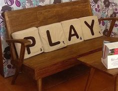 P L A Y Letter Pillows. We're big Scrabble and game night fans. Would love these for the family room.