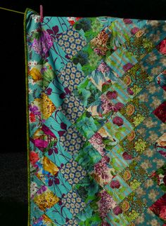 "This could be done with samples.  9- 5-1/2"" squares would make about 45"" length.  Would also be good for all the floral quilt fabric I have.  Jane Brocket Quilt- another one with lovely colour!"