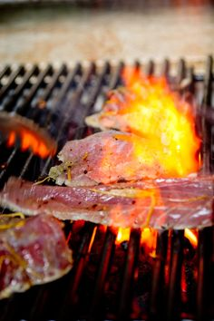 Lemon Grilled Tuna Steaks |  Infused overnight with a marinade of olive oil, salt, coarse black pepper, garlic and lemon zest.