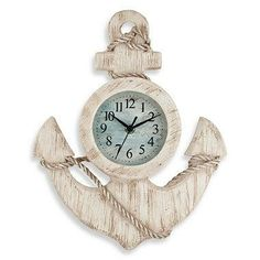 This distinctive wall clock in the shape of an anchor has an antiqued white finish, a sea-blue face, and rope accents. A great gift for any sailor or ocean-lover.