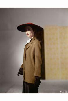 Dovima Wearing a Long Straight Jacket, Pen-Stroke Skirt and a Cartwheel Hat September 1950 by Horst P.Horst
