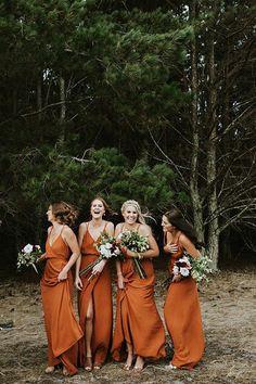 Crushing on these orange bridesmaid dresses!