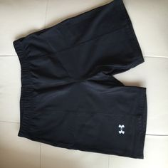 Under Armour shorts Spandex. Fabric is identical to Lululemon luxtreme. Selling due to size drop. No pilling or fading. Camera overexposed to show detail. Come to mid thigh and high rise in waist, not booty shorts. Under Armour Shorts