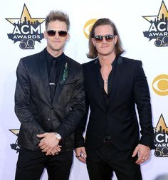 Brian Kelley and Tyler Hubbard of Florida Georgia Line attend the 50th Academy of Country Music Awards at AT&T Stadium on April 19, 2015 in Arlington, Texas.   Watch FGL's pyrotechnic performance of 'Sippin' On Fire' at the 2015 ACMs.