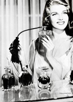 Rita Hayworth applying perfume: Glamour Magazine.