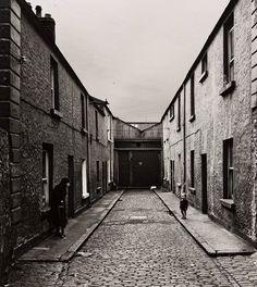 Watching - A Street Scene    photo by Alen MacWeeney, Dublin 1965