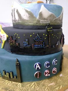 Full tiered cake. bottom:NYC mid: Vegas Top: Montezuma, Colorado