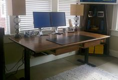 Desk that raises and lowers to be used in sitting or standing position.   www.brendancarpenter.com