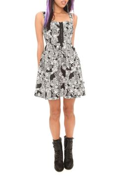 This black dress features a white Day of the Dead print. Added details include a sweetheart neckline, front busk and back zipper closure.