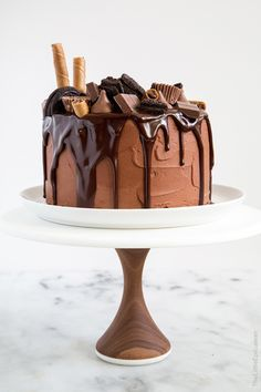 Death by Chocolate Cake. Four layers of rich chocolate cake frosted with decadent chocolate buttercream and topped with melted chocolate. Best Simple Chocolate Cake, Ultimate Chocolate Cake, Decadent Chocolate, Chocolate Desserts, Chocolate Chocolate, Chocolate Cake Frosting, Death By Chocolate Cake, Melting Chocolate, Best Dessert Recipes