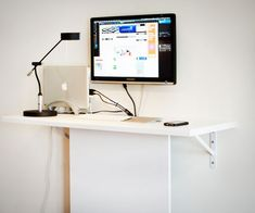 Space Saver: 22 Wall-Mounted Desks to Buy or DIY via Brit + Co.   20. DIY Standing Desk: This DIY standing desk uses a basic white painted board to camouflage unsightly computer cords on their way to the power outlets. If you're looking for a more colorful solution, try wrapping them with neon embroidery floss! (via Shelterness)
