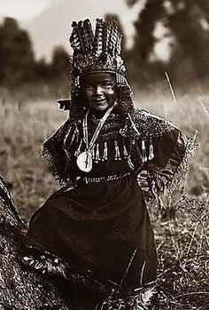 Here we present an historic image of Flathead Childhood. It was taken in 1910 by Edward S. Curtis.    The image shows Salish Indian boy, posed, wearing costume and headdress.    We have created this collection of images primarily to serve as an easy to access educational tool. Contact curator@old-picture.com.