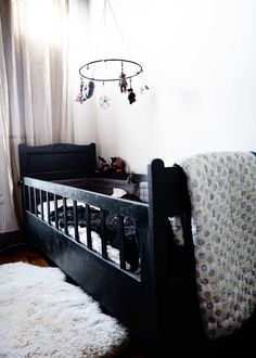 This gorgeous crib and sweet mobile are perfectly charming.