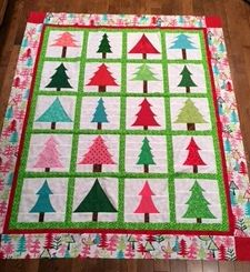 "Chris Powell's version of ""Spring into Christmas"" pattern from Happy Stash Quilts."