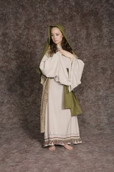 $20.00 Nativity Woman #4 off white dress w/colored fringe, brown textured long vest, green sash, green headpiece