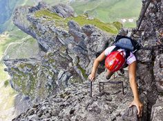 Picture of hiker ascending the via ferrata in the Dolomites in Italy