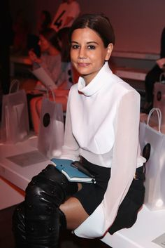 This is Christine Centenera... A twist on the white blouse and Chanel thigh high boots. Black and white elegance. #blackandwhite