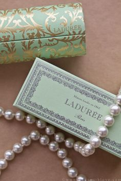 Pearls + Laduree boxes I LOVE LADUREE. their caramel macaroons are my favorite in the whole world!