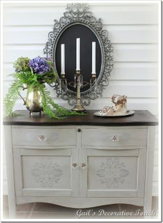 Painted using two shades of homemade gray chalk paint.  First painted with a…