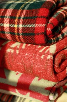 I keep a vintage, red wool plaid blanket in the back of my Jeep - using it makes me happy.