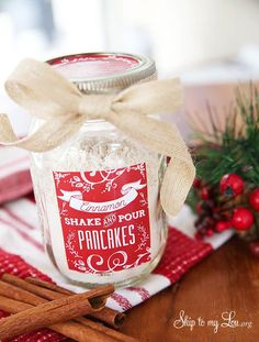 Homemade pancake mix in a jar is great for a gift basket. Add gourmet flavored syrups, towel, wooden spoons, and wire whisk for a complete gift at TidyMom.net