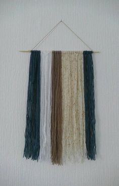 Check out this item in my Etsy shop https://www.etsy.com/uk/listing/495030296/boho-wall-hanging-wool-fibre-art-blue