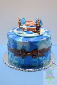 Blue Camo Baby Shower Cake - Cake covered with mmf. Gum paste topper. I used a mold for the baby, rattle, and baby bottle. www.facebook.com/cakesbyyari