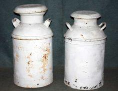Old rusty vintage milk cans