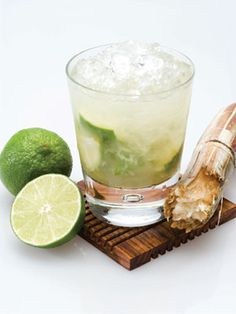 The Caipirinha is the unofficial national drink of Brazil, made solely with local ingredients and passion. The Leblon Caipirinha drink recipe is made from Leblon cachaca, sugar and lime, and served muddled in a rocks glass full of ice. Spring Cocktails, Summer Cocktails, Cocktail Drinks, Fun Drinks, Beverages, Cocktail Shaker, Cocktail Attire, Refreshing Cocktails, Popular Cocktails