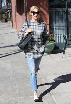 Kelly Rutherford's plaid sweatshirt and white sneakers