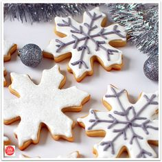 Snowflake cookie Cut out sugar cookies with royal icing Great for Christmas cookie exchange, bake sales, cookie trays and homemade holiday gift idea.  Recipes at TidyMom.net