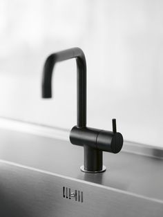 The classic Arne Jacobsen-designed Vola KV1 Mixer Faucet in black