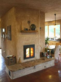 Contraflow heater with clay plaster finish by  Gimme Shelter
