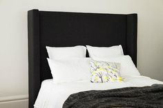 Upholstered bedhead clean lines and side wings. Choose from our range of BedNest fabrics.