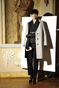 I love this uncluttered, modern classic look (borrowed from traditional men's cuts and constructions) by designer Alber Elbaz (Lanvin Pre-Fall 2013): black, gray, and white, coupled with lots of different textures (leather belt/gloves, laced patent boots, pale gray wool and Neoprene coat with contrast collar and buttons). The ivory hand clutch is simple and sweet.