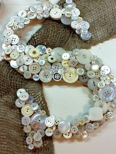 How to Make a Button Covered Letter  - info on how collected buttons are glued and layered onto a craft store letter - A Lettered Life