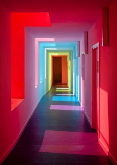 """sixpenceee: """" The effect of colored glass on white walls. This is a nursery school in El Chaparral, Granada, Spain that was designed by Alejandro Muñoz Miranda. Neon Lighting, Corridor Lighting, Lighting Ideas, Interiores Design, White Walls, Red Walls, Paint Walls, Colored Glass, Rainbow Colors"""