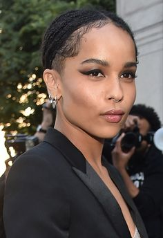 Brushed-up brows are the way Zoë Kravitz rolls, ideal for giving smokey eyes a bit of edge. Nude, glossy lips are the perfect low-key finish