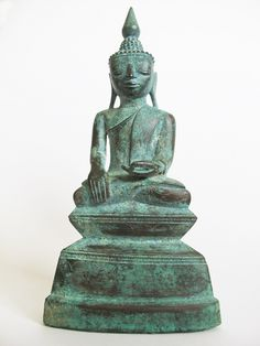 G495.3 (JA3) A Bronze seated Buddha with a dedicatory inscription on the pedestal Burma Shan States 18th century H.21 cms,8 1/4 ins