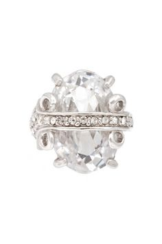 The Regal Faceted Cocktail Ring is an oversized crystal cocktail ring with stunning silvertone detail that will surely get you plenty of compliments!