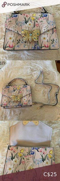 Aldo floral two way bag Brand new flower design two way. Pocket at the back and inside. Would fit long wallet, phone and more   Stones in the butterfly design are all intact. Nothing missing. No rubbings in the corners  Strap is adjustable. Perfect  crossbody bag!  Hardwares are all shiny Aldo Bags Crossbody Bags Black Crossbody Purse, Crossbody Bags, Aldo Handbags, Aldo Purses, Guess Purses, Purse Brands, Butterfly Design, Quilted Bag
