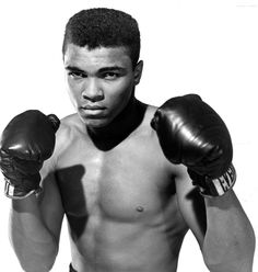 Muhammad Ali: Professional boxer Muhammad Ali is known for his cocky attitude and prowess both inside the ring when fighting an opponent or outside the ring fighting injustice. (Photo by: The Ring Magazine/Getty Images)