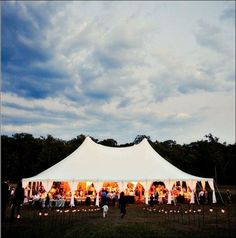 There is something warm&magical about white tent weddings in a backyard or open field