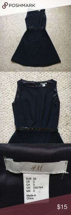 H&M fit and flare dress This is a cute solid navy blue dress. Flares out just below the waist line. Size 2. Comes with a little black belt that snaps into place. The back has a zipper with a button at the top. H&M Dresses Midi