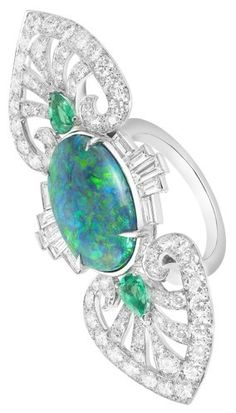 BOUCHERON Indian Palace Ring Inspired by the colored pools found on the grounds of ancient Indian palaces, this opal ring from the house's new Fleur des Indes collection sparkles like the surface of water.