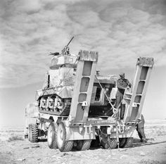 Men of the Royal Electrical and Mechanical Engineers secure a Grant tank onto a Scammell tank transporter before taking it to a light repair workshop, 19 January Military Pictures, Ww2 Pictures, Army Vehicles, Armored Vehicles, Afrika Corps, North African Campaign, British Armed Forces, Soviet Army, Ww2 Tanks