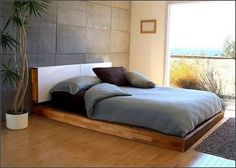 "Stone wall - serves as a ""headboard"" detail. Could be faux painted! Large, clean rectangles make it look contemporary."