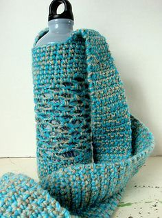 A crochet holder for your water bottle with a cross-body strap.